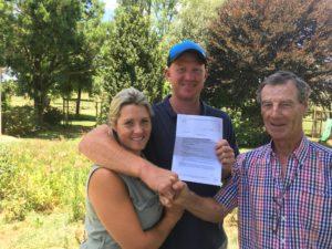 Mr Ian Davis (right) congratulated